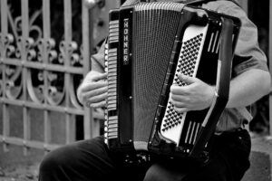 black and white photo of someone playing accordion