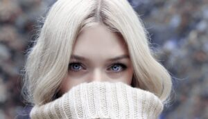 a blonde woman with blue eyes