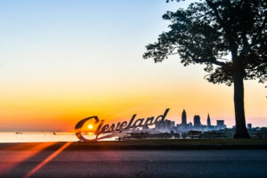 the Cleveland sign at Edgewater park at sunset with the Cleveland city skyline behind it