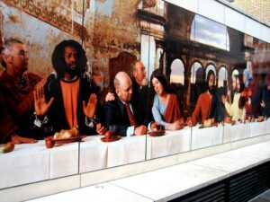 a photographic recreation of the Last Supper with actual people