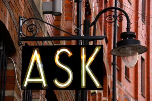 a street sign that says ask on it
