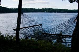 rope hammock next to a lake