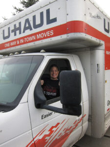 a person sitting in a Uhaul truck