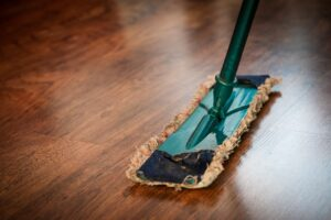 a mop on a wood laminate floor