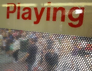 """a sign that says """"Playing"""""""