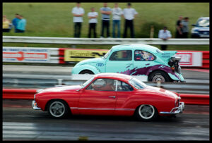 two cars racing one another that are neck and neck