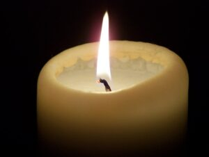 a lit candle burning