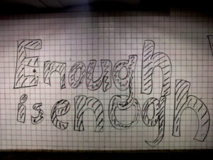 """a piece of graph paper that has the words """"enough is enough"""" written on it"""