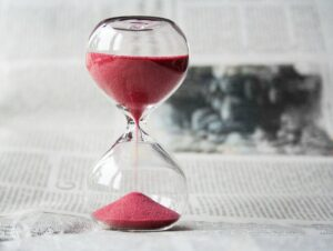 an hour glass filled with red sand