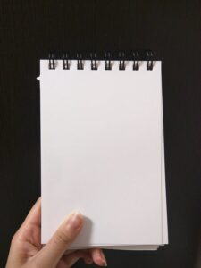 a blank page of a spiralbound notepad