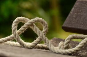 a brown rope with a knot tied into a heart shape