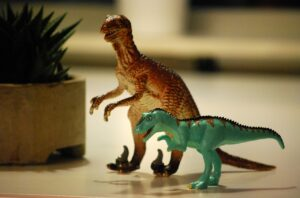 two toy dinosaurs