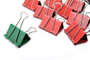 8 red binder clip and 1 green clip
