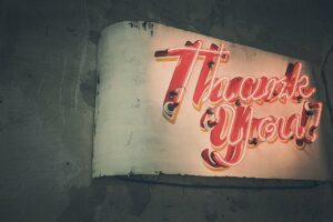 """a neon sign that reads """"Thank You!"""""""