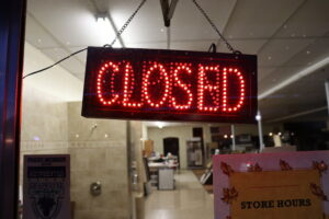 """a lit sign that says """"closed"""""""