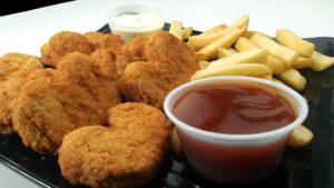 chicken nuggets, fries, and ketchup