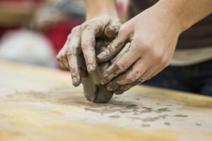hands wedging a piece of clay