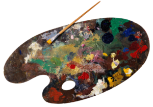 a paint palette with brush and a mix of various paints on it