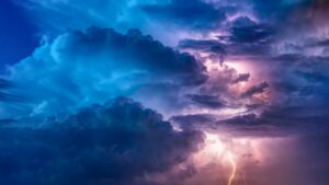 a thunderstorm shot up high in the clouds
